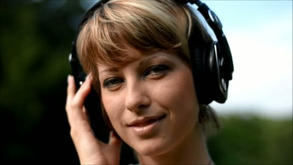 Pretty blonde young woman listening to music with headphones