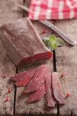Traditional Bulgarian dried meat decorated with pink pepper