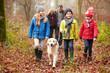 Family Walking Dog Through Winter Woodland - 66129707