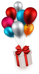 Gift box on colorful balloons.