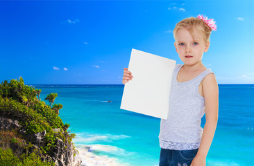 little girl near the ocean