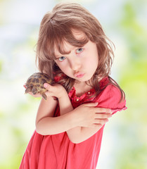 Little girl with a turtle