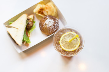 Iced tea and lemon with sandwiches