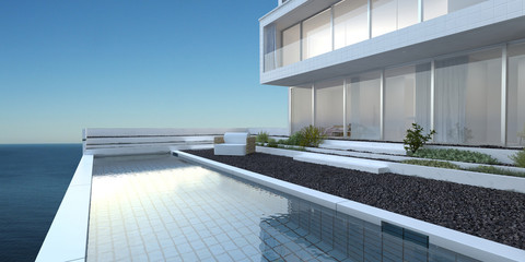 House with patio and pool overlooking the sea