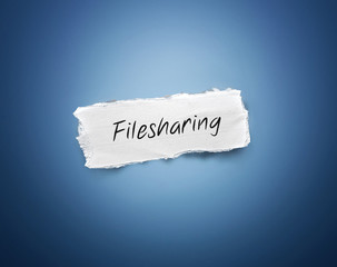 Scrap of torn paper with the word - Filesharing