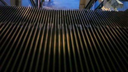 Moving stairs seen from above. Macro escalator in motion