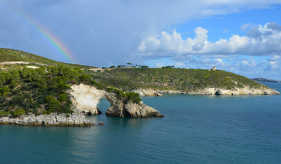 Rainbow over the rock window near Vieste
