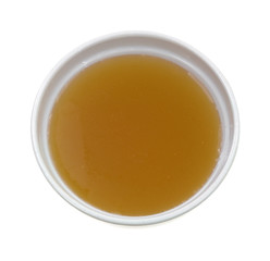 Chicken broth top view in bowl on a white background