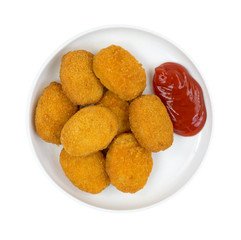 Serving of chicken nuggets with ketchup