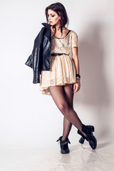 Rock style beautiful young woman. model. evening dress