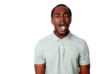 Portrait of african man shouting isolated on white background