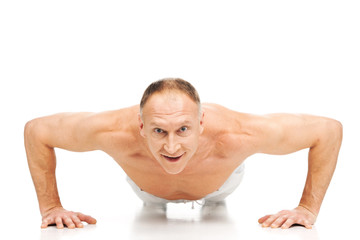 handsome muscular man doing push-ups.