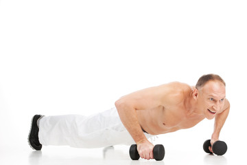 aged muscular man doing push-ups.