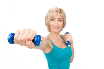 aged woman workout using dumbbells.