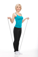 aged woman standing on jumping rope.
