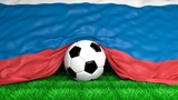 Soccer ball with Russian flag on football field closeup