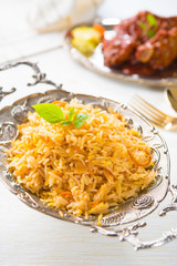 biryani rice with chicken on background