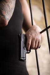 gangster man standing and holding gun.