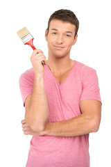 painter holding paintbrush on white background.
