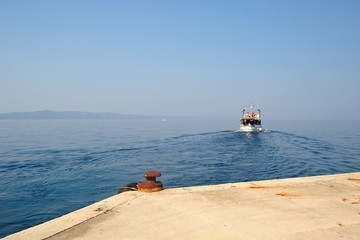 Port of Podgora with departing ship in background