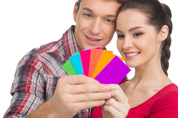 beautiful couple selecting color and smiling.