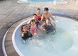 big family people  and brothers relaxing in water pool with happ
