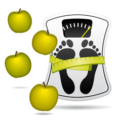 White bathroom scale with apples. Diet concept.