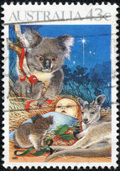 stamp shows Baby Jesus Nativity, koala and kangaroo