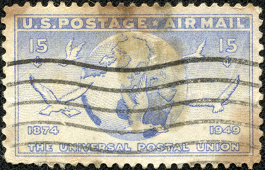 stamp shows Globe and doves carrying messages