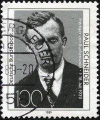 stamp printed in Germany shows image of Paul Schneider