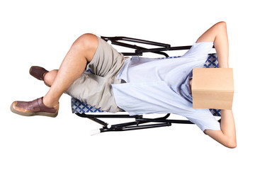 Young man relaxing, reading lying on  deckchair, isolated white