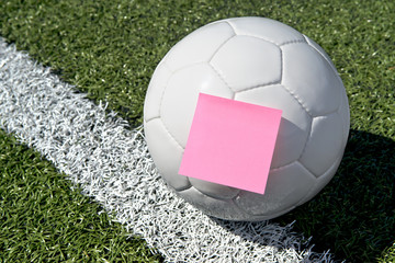 Soccer ball and sticky note