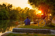 Embankment in Treviso, Italy, guy alone relax, enjoy the sunset