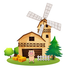 A playful pig outside the wooden barnhouse with a windmill