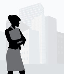 Silhouette of a businesswoman holding a folder