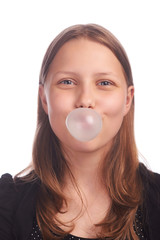 teen girl blowing bubbles on white background