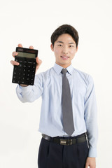 Asian bank teller with a calculator