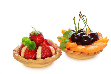 Fruit tartlets on white