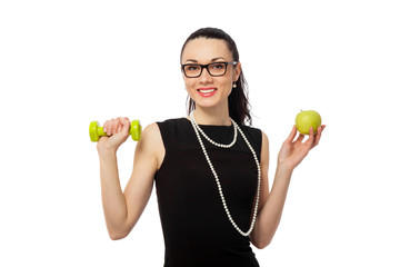 brunette businesswoman  holding apple and dumbbells