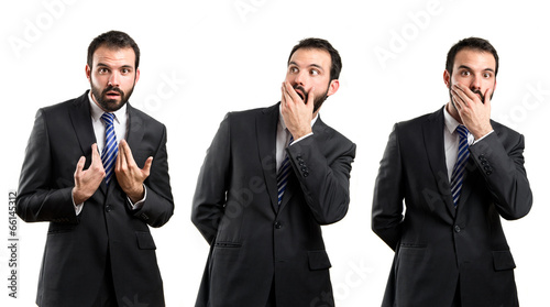 Young businessman surprised over white background