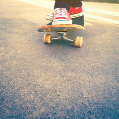 skateboarder trick at beach road
