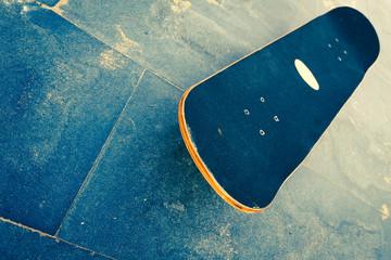 skateboard on beach floor
