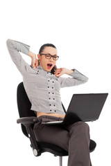 businesswoman yawning in the office chair with laptop