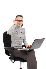 businesswoman sitting in the office chair with laptop