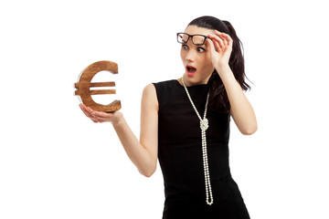 astonished woman wearing black dress holding euro sign