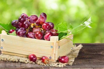 Red grapes in wooden box