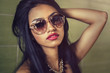 Beautiful young woman wearing sunglasses