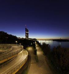 Vienna with the Millennium Tower and Danube River at night