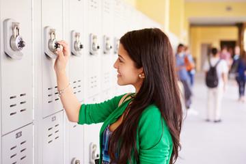 Female High School Student Opening Locker