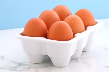 Fresh eggs on kitchen station